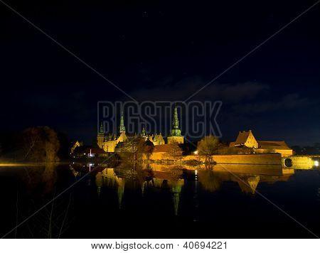 Frederiksborg Castle iluminated in winter night