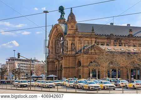 Historic Building From The Main Train Station In Frankfurt. Street With Traffic Lights And Cars With