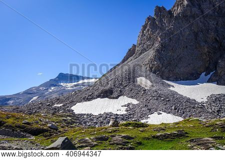 Alpine Glaciers And Neves Snow Landscape In Pralognan La Vanoise. French Alps.