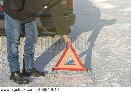 Street Lighting. White Snow. The Man Puts An Emergency Sign. Damage To The Vehicle.