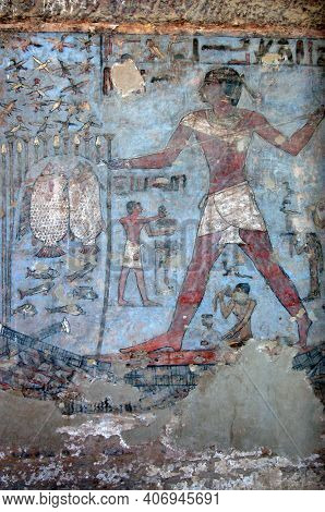 Detail Of An Ancient Egyptian Tomb Painting In Aswan, Egypt. The Main Figure In The Painting Is Mekh