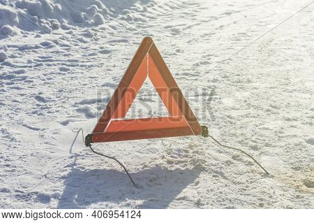 Street Lighting. White Snow. Street Lighting. White Snow. There's A Pack Sign On It. Warns Of A Car