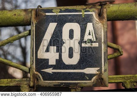 Weathered Grunge Square Metal Enameled Plate Of Number Of Street Address With Number 48 A