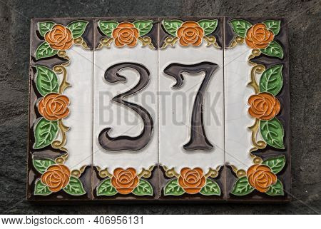 Weathered Grunge Square Faience Enameled Decorated Plate Of Number Of Street Address With Number 37