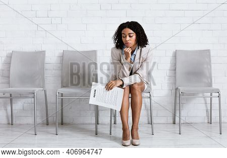 Bored Black Woman With Cv Tired Of Waiting For Employment Interview At Office Lobby, Free Space. Fem