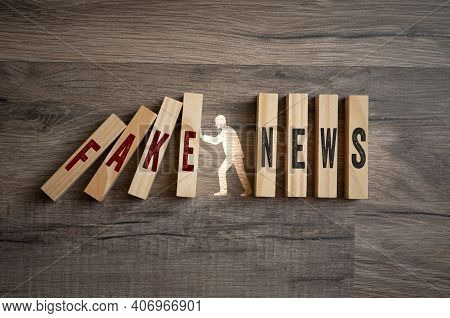 Pieces Of Wood With Letters Fake News On Wooden Background