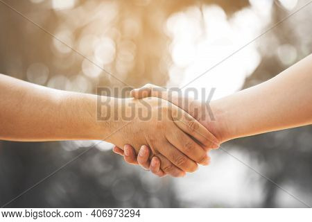 Men Greet Each Other And Shake Hands Meet In The Park Vintage Image Concept