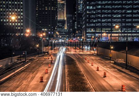 Long Exposure Of Car Light Trails On Columbus Drive With Elevated Randolph Street In The Background,