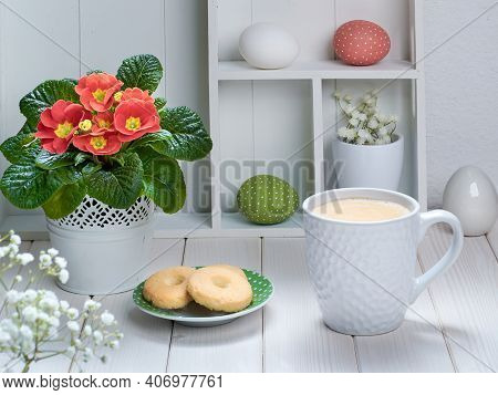 Springtime Background With Coffee, Cookies And Spring Decorations. Display Cabinet With Springtime D