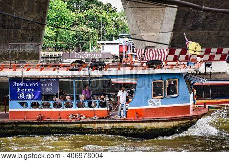 Bangkok, Thailand 08.20.2019 A Ferry With Passengers Beneath The Taksin Bridge, Close To The Sathorn