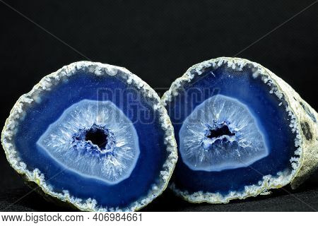 Blue Agate Stone Cut In Half. Agate Is Formed By Rhythmic Deposition Of Silica, Usually Within Amygd