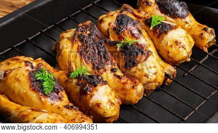 Fried Chicken Drumsticks Marinated In Red Marinade With Turmeric, Garlic, Mustard And Parsley. Chick