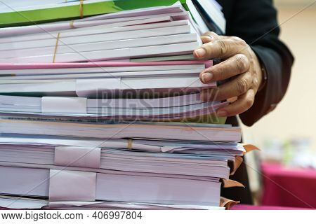 Office Workers Arranging Stacks Of Lot Documents Report Papers Waiting Be Managed On Desk In Busy Of
