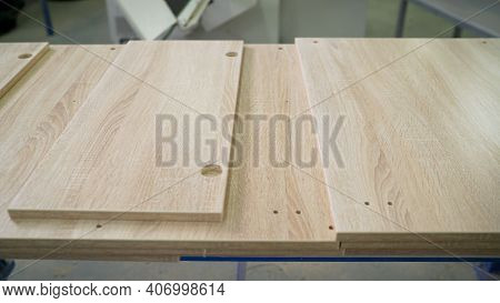 Joinery. Woodworking And Carpentry Production. Furniture Manufacture. Drilling Holes In Wood Panel I