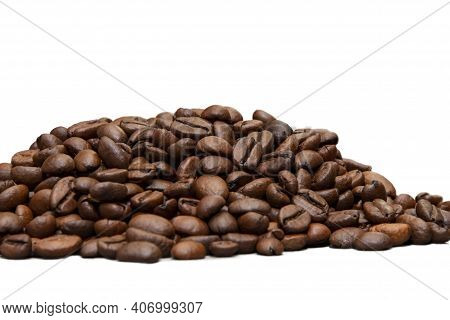 A Pile Of Roasted Coffee Beans On A White Background,  Selective Focus, Isolate.