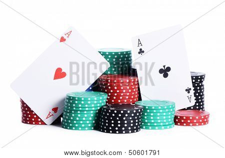 Ases and casino chips isolated on white