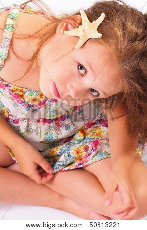 Attractive Little Girl With Starfish