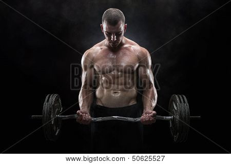 Close up of young muscular man lifting weights over dark background poster