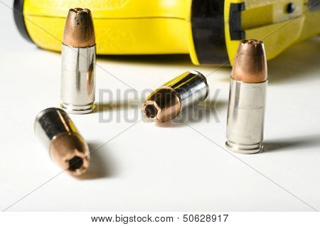 a close up of a police stun gun and bullets. poster
