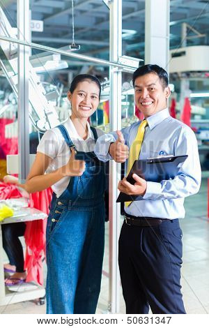 Indonesian Seamstress is new assigned in a textile factory, the foreman gives her training for the new job