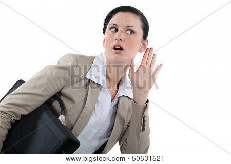 Businesswoman struggling to hear
