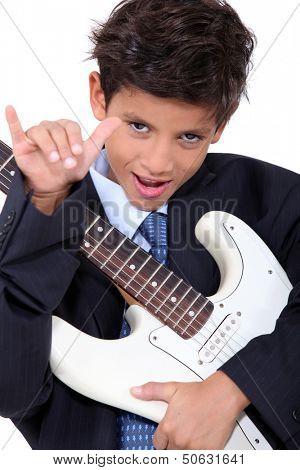 A little boy playing guitar