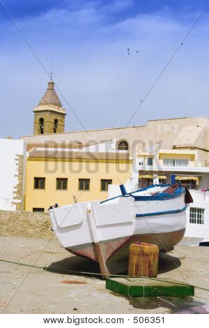 Boat And Church Tower