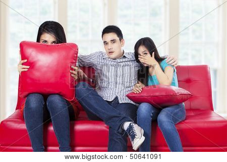 Three Young Teenagers Watching Tv