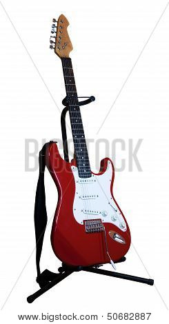 Red Electric Guitar On A Stand