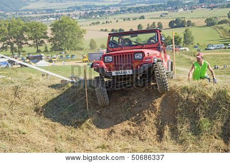 Red Suv At Difficult Terrain