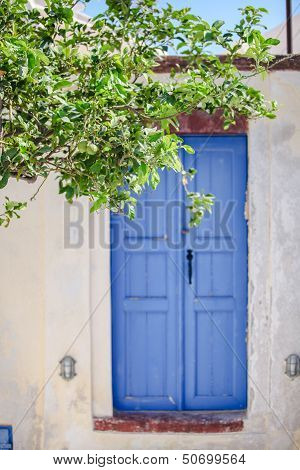 Old House And Blue Door At Emporio Village Of Santorini Island In Greece