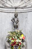 The famous Manneken Pis statue in the centre of Brussels. poster