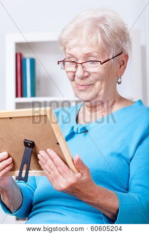 Elderly Lady Viewing Family Picture