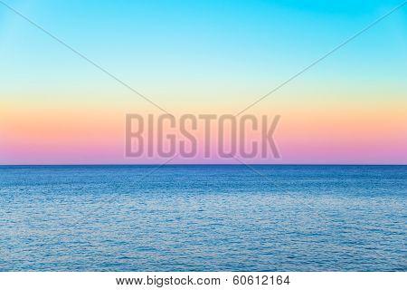 Pastel Sky With A Calm Sea Beneath