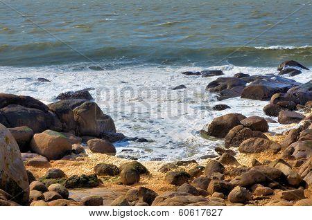 Sea, foam and rocks