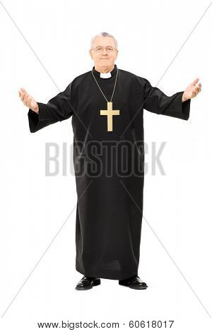 Full length portrait of mature reverend in black mantle with open hands isolated on white background
