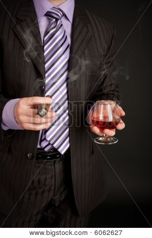 Successful Businessman With Glass Of Cognac And Good Cigar