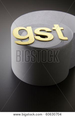 GST alphabet on the adding machine tape