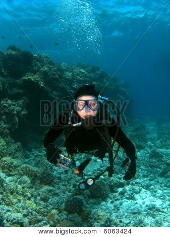 Scuba Diver Looking Into The Camera In Hawaii