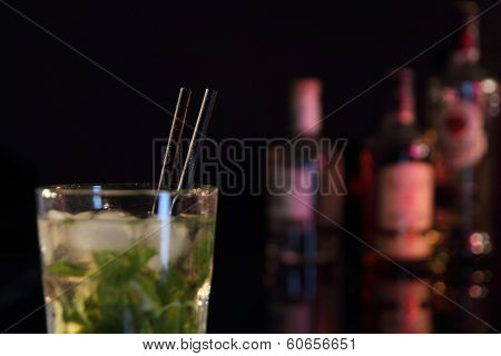 Cocktail On A Bar With Bottles