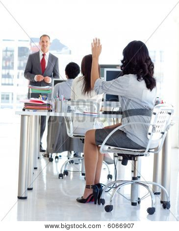Busineswoman Asking A Question In A Meeeting Office