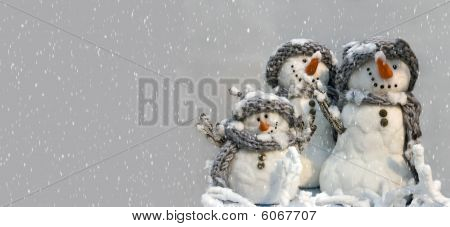 background for xmas card of three snowman