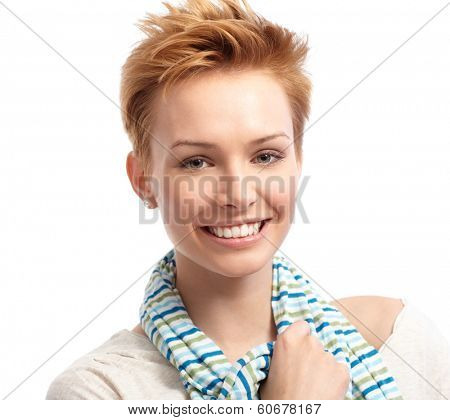 Closeup portrait of fresh woman with short gingerish hair, smiling.