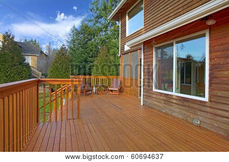 Back Of The House With A Wooden Deck