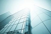 Panoramic and perspective wide angle view to steel light blue background of glass highrise building skyscraper, modern futuristic commercial city Business concept of successful industrial architecture poster
