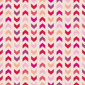Aztec Chevron seamless vector colorful pattern, texture or background with zigzag stripes. Pink, violet, orange and red background, desktop wallpaper or website design element poster