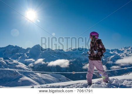 Young Woman In High Mountains. Winter