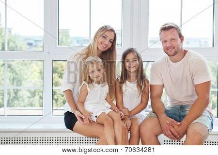 Happy Toung Family With Kids At Home