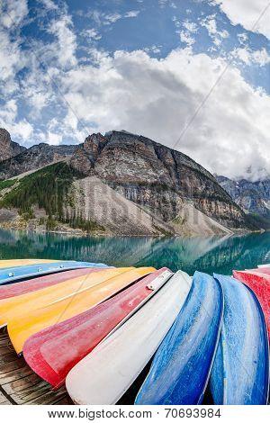 Kayaks On Moraine Lake In The Canadian Rockies
