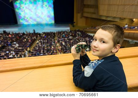 9-year boy with binoculars in a theater amphitheatre poster